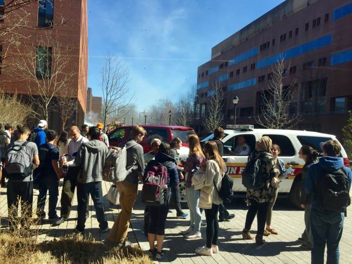 Students stand outside of Oak Hall after the fire alarm went off around 3:10 p.m. on Wednesday, April 20, 2016, delaying classes.(Cheyenne Haslett/Daily Campus)