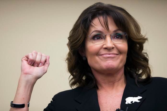 """Sarah Palin speaks during a panel discussion before a preview of the film """"Climate Hustle"""" on Capitol Hill, on Thursday, April 14, 2016, in Washington.Palin says voters won't stand for it if Republican power brokers try to take the presidential nomination away from Donald Trump or Ted Cruz at the GOP convention this summer. (AP Photo/Evan Vucci)"""