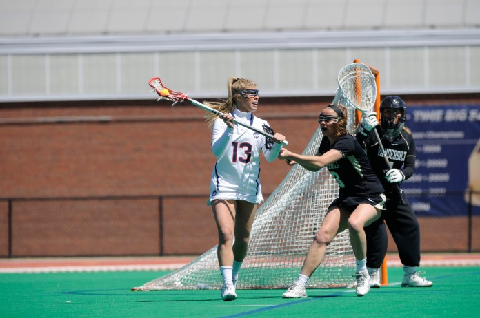 UConn senior attack Carly Palmucci carries the ball during the Huskies' game against Vanderbilt at the Sherman Family Sports Complex in Storrs, Connecticut on Saturday, April 16, 2016. (Jason Jiang/The Daily Campus)