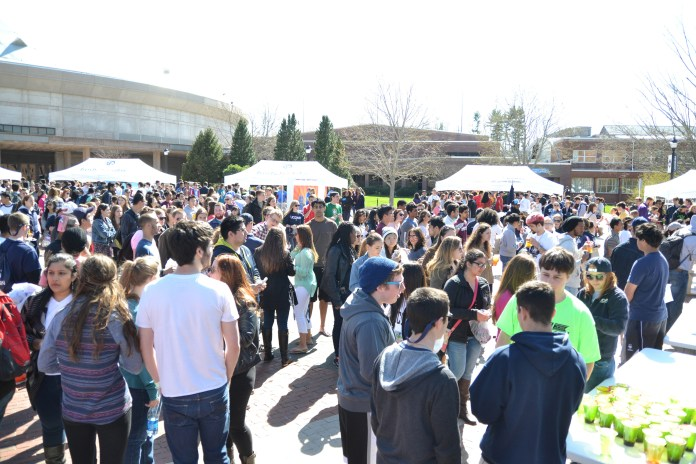 Students on Fairfield Way on the UConn campus in Storrs, Connecticut during Spring Weekend in April 2015. (Amar Batra/The Daily Campus)