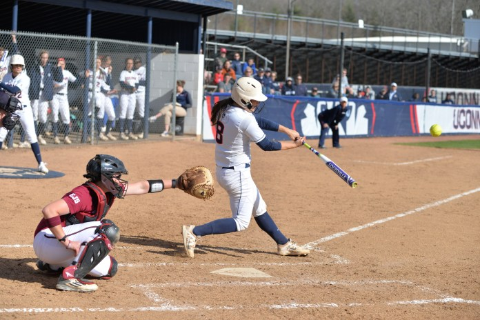 Senior Lexi Gifford hits a ball during a game against UMass on Tuesday, April 19 at Burrill Family Field. (Amar Batra/The Daily Campus)