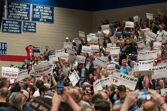 Attendees hold signs at a Donald Trump rally in Waterbury, Connecticut on Saturday, April 23, 2016. (Kyle Constable/The Daily Campus)