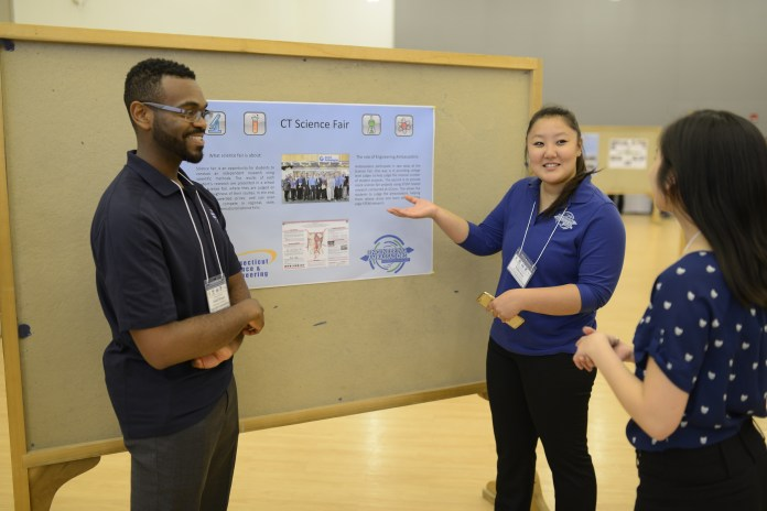 University of Connecticut students show off their posters centering around outreach and diversity programs during the UConn Engineering Diversity Program and Outreach center's showcase in the Student Union Ballroom on Monday, April 25, 2016. (Jason Jiang/The Daily Campus)