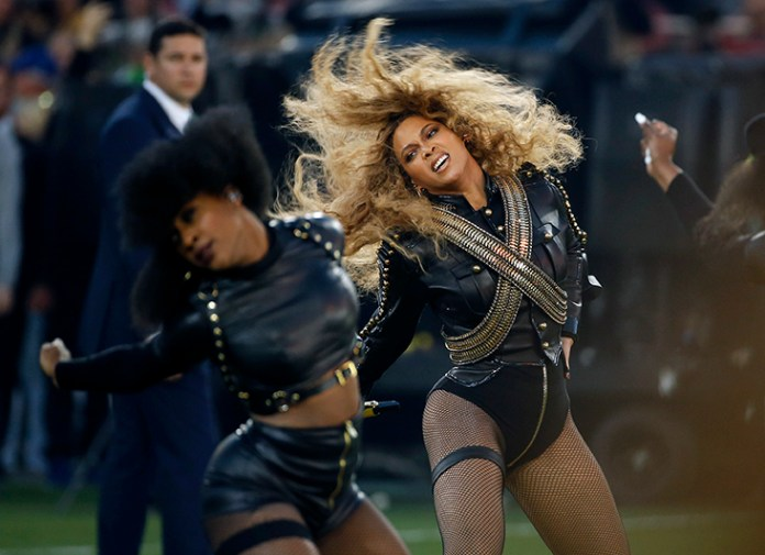 """FILE - In this Sunday, Feb. 7, 2016, file photo,Beyonce performs during halftime of the NFL Super Bowl 50 football game in Santa Clara, Calif. After the recent debut of her visual album """"Lemonade"""" on HBO, a Ticketmaster representative told The Associated Press on Wednesday, April 27, that the ticket outlet company saw searches forBeyoncé's concerts increased by 116 percent compared to last week. (AP Photo/Matt Slocum, File)"""