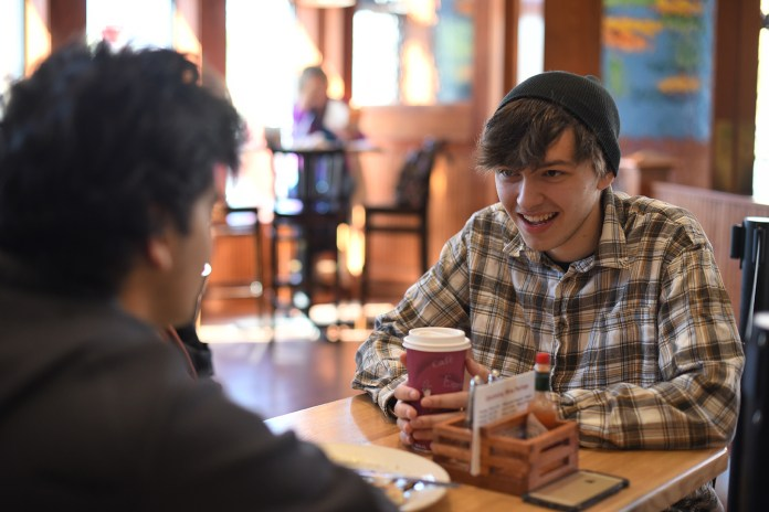 Alex Kuvalanka, junior majoring in history, discusses his personal life. (Zhelun Lang/The Daily Campus)