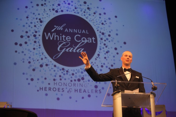 Ryan Radue speaks to a crowd of nearly 700 attendees at the 7th annual White Coat Gala at the Connecticut Convention Center in Hartford on Saturday, April 16, 2016. The event raised $100,000 more than last year's, including an extra $55,000 in donations and pledges made during the event. (Photo courtesy of UConn Foundation)