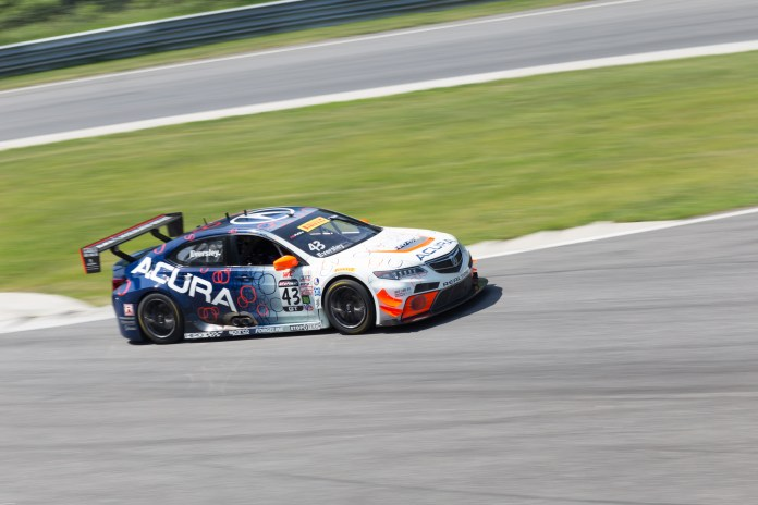 Ryan Eversley navigates his Acura TLX-GT through the uphill chicane in the GT practice session. There were three practice sessions in the morning, each 30 minutes in length, and three races in the afternoon, each 50 minutes in length.(Jackson Haigis/Daily Campus)