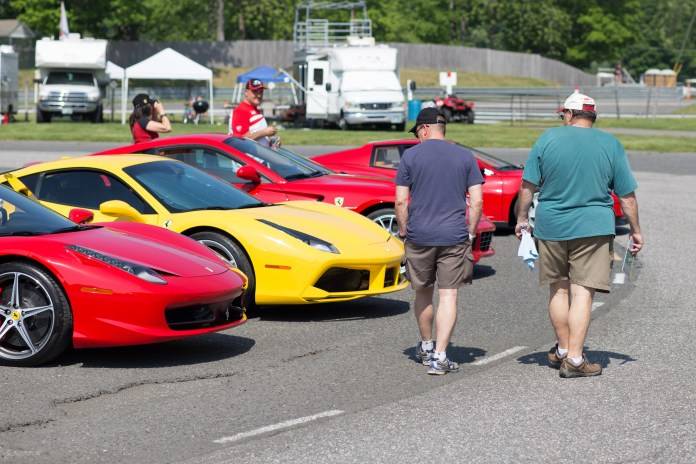 Also in the center of the track is a parking area with areas reserved for various car clubs. Here a few fans check out the Ferraris located in Miller Motorcars' area.(Jackson Haigis/Daily Campus)