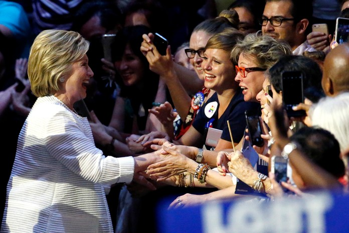 Democratic presidential candidate Hillary Clinton, left, is greeted by supporters as she arrives to a presidential primary election night rally, Tuesday, June 7, 2016, in New York. (AP Photo/Julio Cortez)