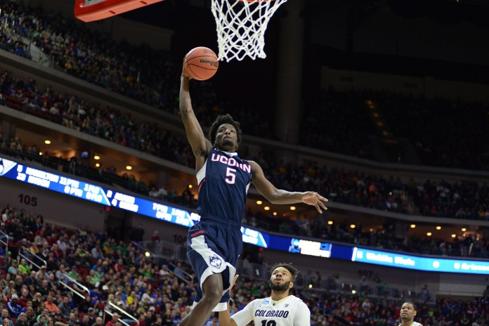 Daniel Hamilton rises for a dunk during UConn's first round victory over Colorado in the NCAA tournament. On Thursday night, Hamilton became the 41st former Husky to be selected in the NBA Draft. He was chosen with the 56th pick by the Denver Nuggets. (File photo/The Daily Campus)
