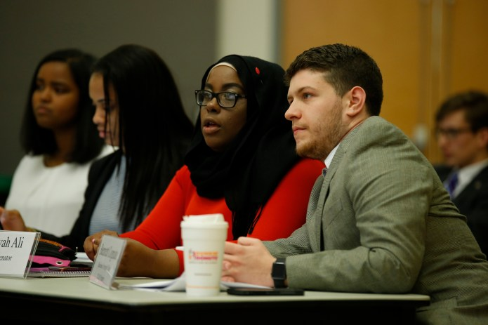 USG senators Haddiyyah Ali (left)and Bennett Cognato (right) pictured at a USG meeting in the UConn Student Union in Storrs, Connecticut on March 30, 2016. Ali authored the bill calling for UConn to revoke Bill Cosby's honorary degree, which he was awarded in 1996.(Tyler Benton/The Daily Campus)