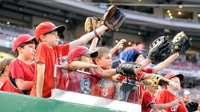 A pack of young fans eagerly attempt to garner the attention of their favorite team, the Washington Nationals.The MLB is facing a crisis with its youngest generation of fans: they are statistically watching less games than their parents or grandparents. (Photo courtesy of rantsports.com)