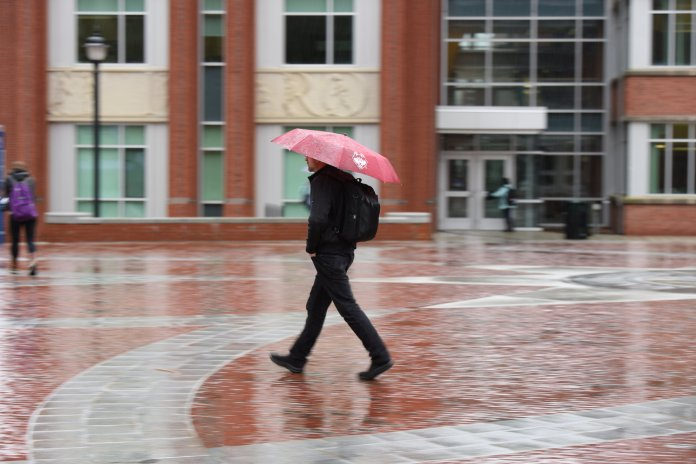 A student walks in front of Homer Babbidge Library. (Zhelun Lang/Daily Campus)