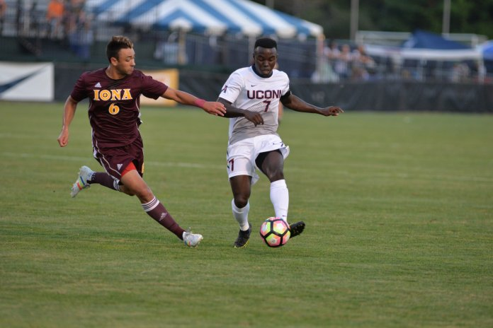 Senior co-captain Kwame Awuah dribbles by an Iona defender in UConn's season opening 3-1 victory at Morrone Stadium on Aug. 26, 2016. (Amar Batra/The Daily Campus)
