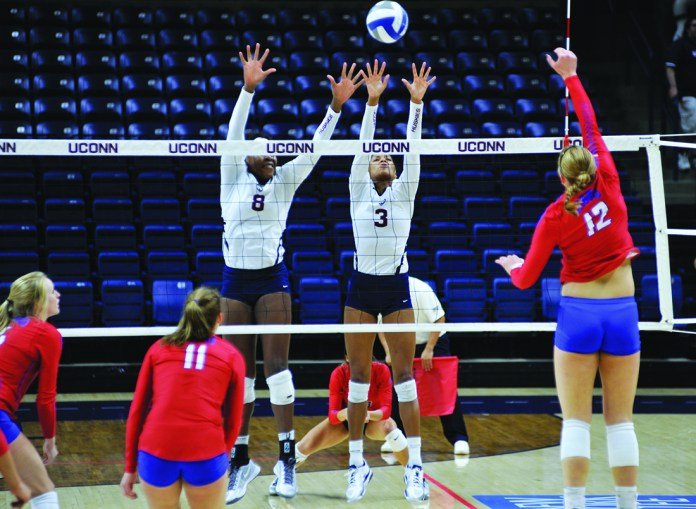 UConn's outside and middle hitters Jade Strawberry (#3) and Immanuella Anagu (#8) rise for a block during their 3-0 loss against SMU. Strawberry was named All-American Athletic conference. (Jason Jiang/The Daily Campus).