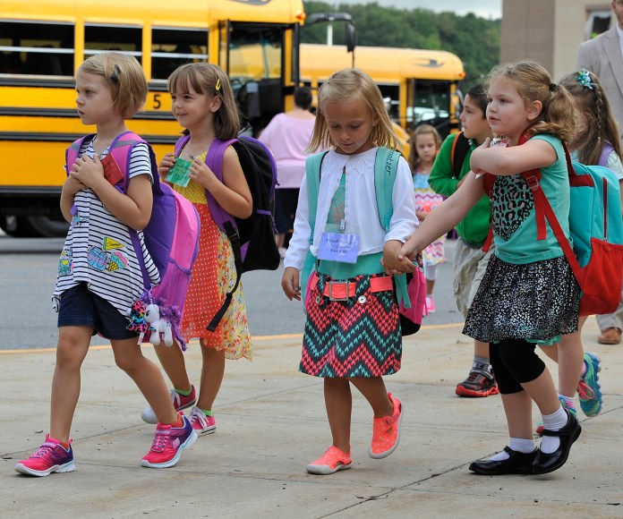 Forest Hills  elementary  school kindergarten students walk to class on the first day of  school in Sidman, Pa., on Monday, Aug. 22, 2016. (Todd Berkey/The Tribune-Democrat via AP)