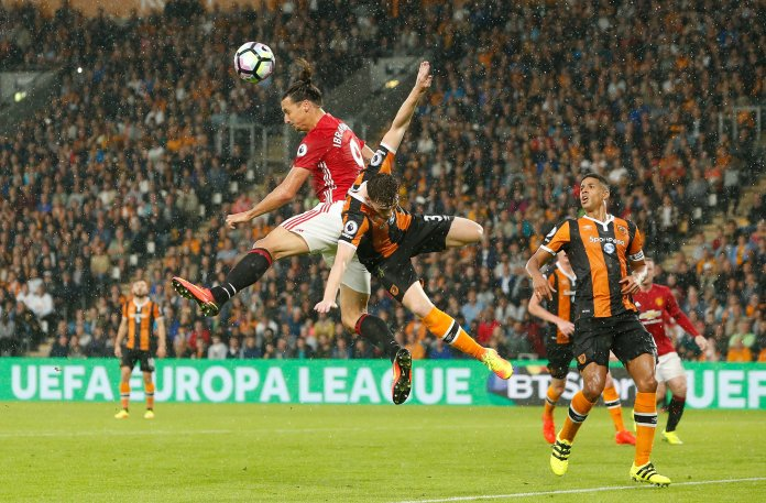 Manchester United's Zlatan Ibrahimovic, left, wins the header from Hull City's Andrew Robertson during the Premier League soccer match Hull City versus Manchester United at the KCOM Stadium, Hull, England, Saturday Aug, 27, 2016. (Danny Lawson/AP)
