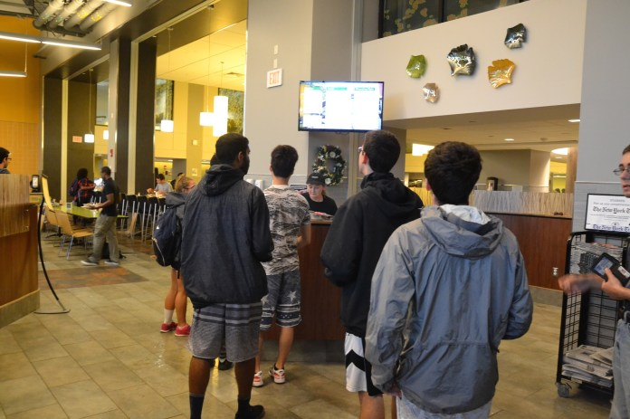 Students swiping into the McMahon dining hall in September of 2015 (Amar Batra/The Daily Campus).