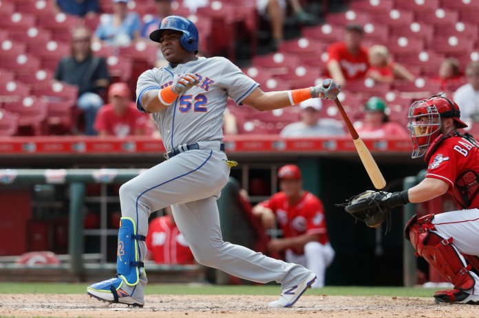 New  York  Mets ' Yoenis Cespedes hits an RBI double off Cincinnati Reds relief pitcher Tony Cingrani in the ninth inning of a baseball game, Wednesday, Sept. 7, 2016, in Cincinnati. The  Mets won 6-3. (AP Photo/John Minchillo)
