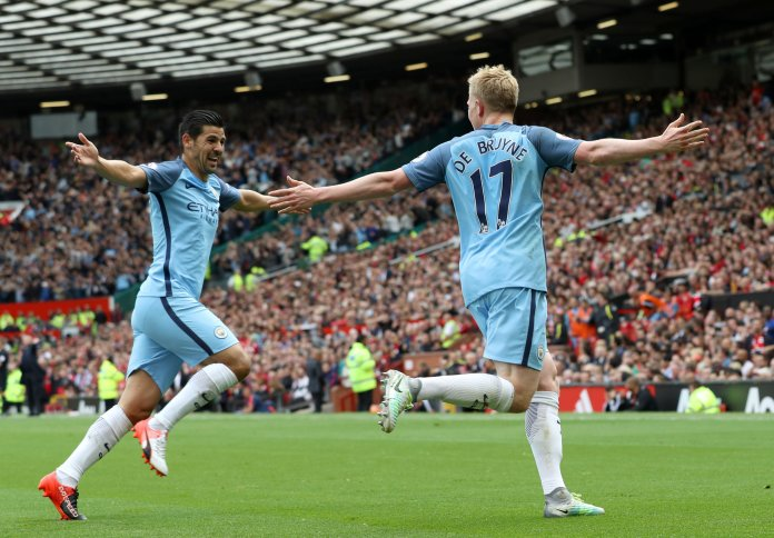 Manchester City's Kevin De Bruyne, right, celebrates scoring his side's first goal of the game with teammate Nolito during the English Premier League soccer match between Manchester United and Manchester City at Old Trafford, Manchester, England, Saturday, Sept. 10, 2016. (Martin Rickett/PA via AP)