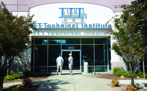"""Harold Poling, left, and Ted Weisenberger found the doors to the ITT Technical Institute campus closed after ITT Educational Services announced that the school had ceased operating, Tuesday, Sept. 6, 2016, in Rancho Cordova, Calif. The Carmel Ind., based company, which operates vocational schools, announced in a statement, Tuesday, that """"with profound regret"""" it is ending academic operations at all of its more than 130 campuses across 38 states. Weisenberger was one quarter short of getting his degree in project management, and Poling was going to began taking classes in cybersecurity next week. (AP Photo/Rich Pedroncelli)"""