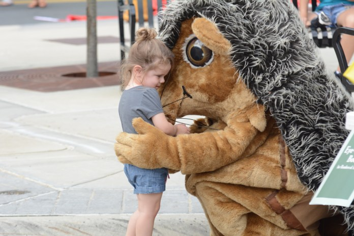 A young girl interacts with the Barnes and Noble mascot at the Celebrate Mansfield on Sunday, Sept. 18 in Storrs center.(Marissa Aldieri/The Daily Campus)