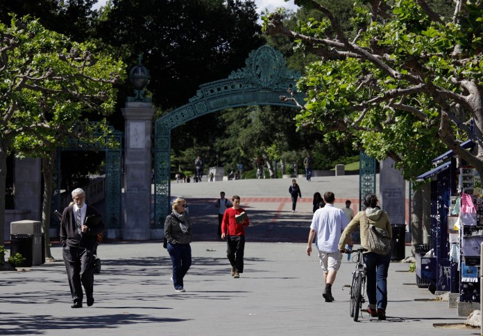 People walk through Sproul Plaza near the Sather Gate on the University of California,Berkeley campus in Berkeley, Calif. The university suspended a class on Sept. 13, 2016, amid complaints that it shared anti-Semitic viewpoints and was designed to indoctrinate students against Israel. (AP/Eric Risberg, File)