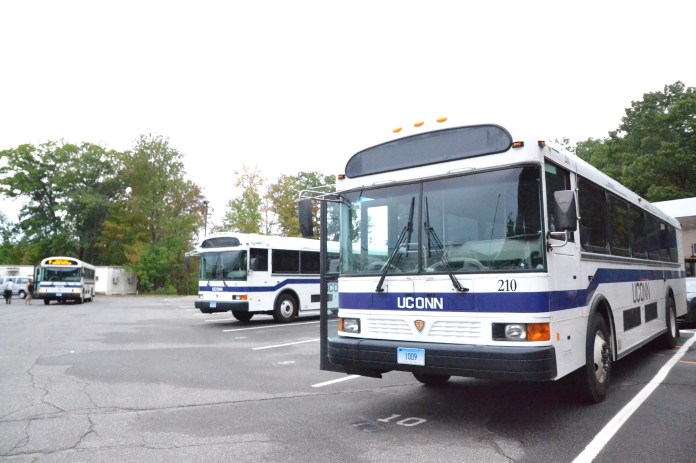 UConn busses, parked in the transportation lot, will now be less likely to be driven by UConn students. A new law has made it far more difficult to employ student bus drivers. (Neel Razdan/The Daily Campus)