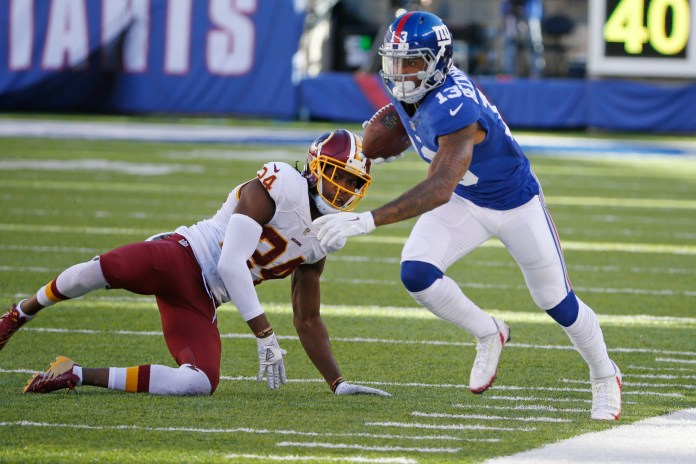 New York Giants wide receiver Odell Beckham Jr. (13) runs away from Washington Redskins' Josh Norman (24) during the second half of an NFL football game, Sunday, Sept. 25, 2016, in East Rutherford, N.J. (Kathy Willens/AP)