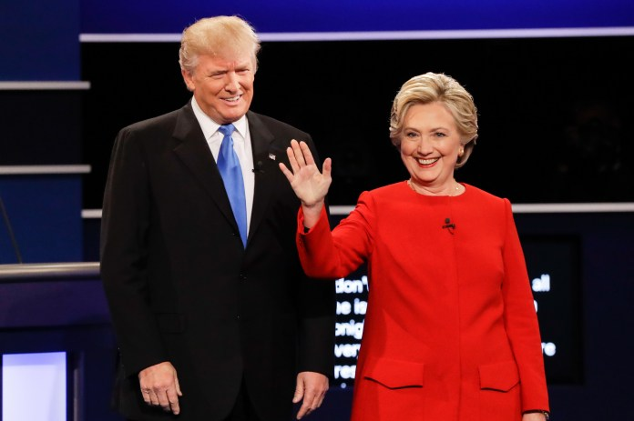 Republican presidential nominee Donald Trump and Democratic presidential nominee Hillary Clinton are introduced during the presidential debate at Hofstra University in Hempstead, N.Y., Monday, Sept. 26, 2016. (David Goldman/AP)