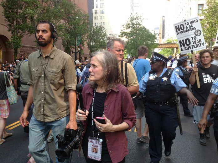 """Amy Goodman, cohost of """"Democracy Now!"""" covering an Occupy Chicago protest in 2012. (Steve Rhodes/Flickr Creative Commons)"""