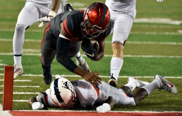 Houston quarterback Greg Ward Jr., top, leaps over Connecticut cornerback Jamar Summers to score a 10-yard touchdown in the second half of an NCAA college football game, Thursday, Sept. 29, 2016, in Houston. (Eric Christian Smith/AP Photo)
