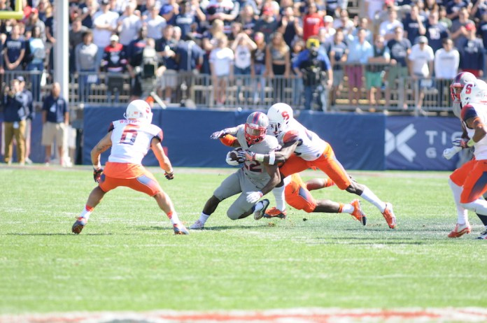 Arkeel Newsome turns upfield during UConn's game against Syracuse. (Amar Batra/The Daily Campus)
