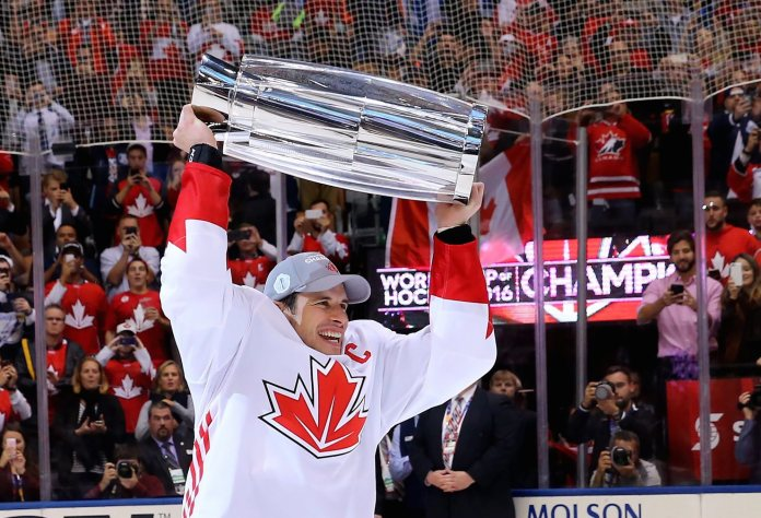 Canada's Sidney Crosby hoists the trophy following his team's victory over Europe in the World Cup of Hockey finals, in Toronto on Thursday, Sept. 29, 2016. (Bruce Bennett/Pool Photo via AP)
