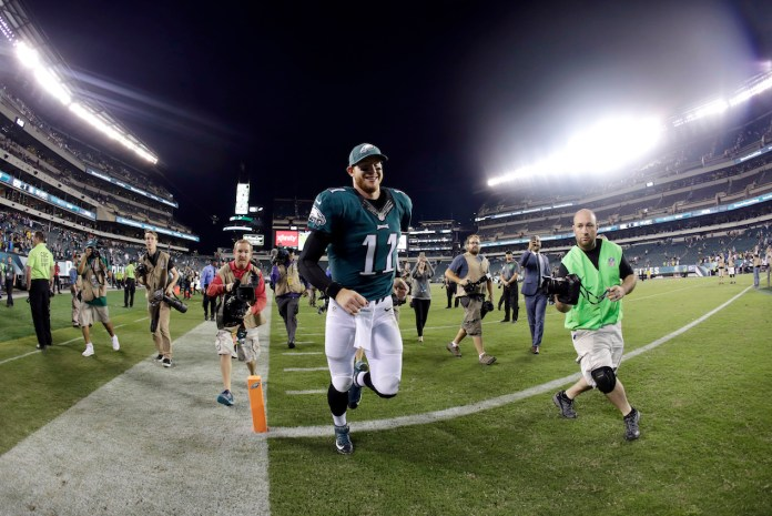 In this Sept. 25, 2016, file photo, Philadelphia Eagles' Carson Wentz runs off the field after their 34-3 win in an NFL football game against the Pittsburgh Steelers in Philadelphia.Wentz and the unbeaten Eagles were the surprise story in the NFL's first month.(Michael Perez/AP)