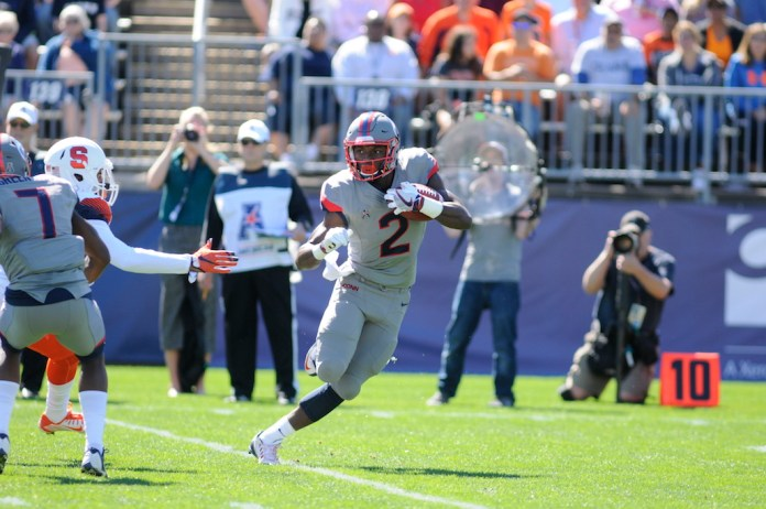 Arkeel Newsmen (#2) breaks off a run in a game against Syracuse on Saturday, Sept. 24 in which the Huskies lost 31-24. The Huskies will play Cincinnati on Saturday, Oct. 8, 2016 at Rentschler Field in East Hartford.(Jackson Haigis/The Daily Campus)