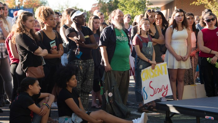 Students listen to peers and politicians at the annual UConn Slutwalk: A March to End Victim Blaming on Friday, Oct. 7, 2016. Students shared personal experiences and concerns, while State Representative Gregg Haddad and Connecticut Senator Mae Flexer spoke of what they've done legislatively to protect sexual assault victims. (Bill Heyne/The Daily Campus)