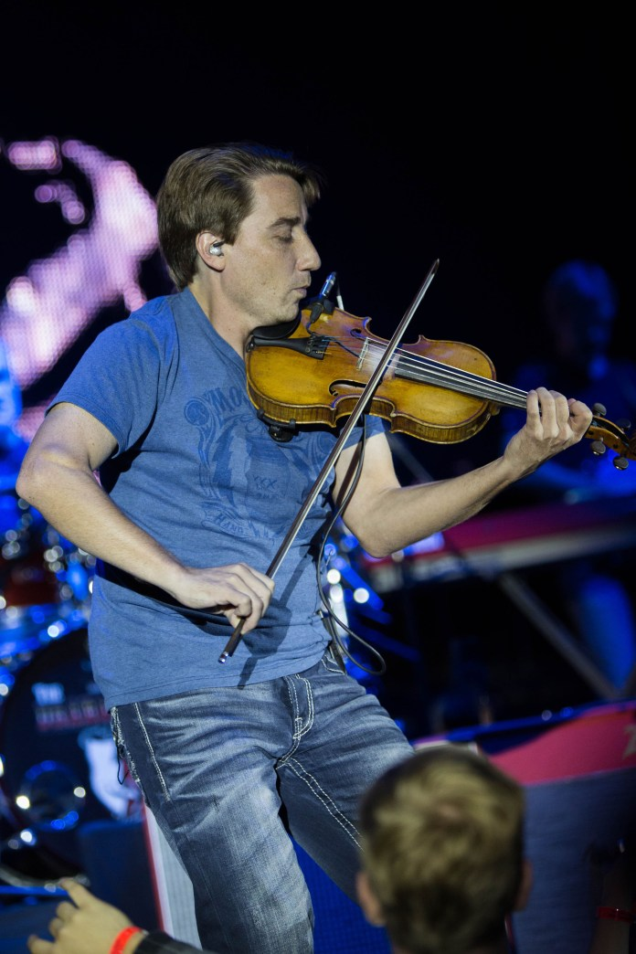Justin Williamson plays the fiddle and mandolin in Paisley's current band. He played with Paisley at the concert in Gampel on Friday, Oct. 7.(Jackson Hanks/The Daily Campus)