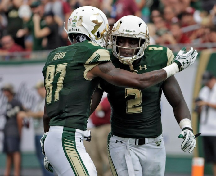 South Florida running back D'Ernest Johnson (2) celebrates with Rodney Adams (87) after Johnson's touchdown run against Florida State during the fourth quarter of an NCAA college football game Saturday, Sept. 24, 2016, in Tampa, Fla. Johnson ran for three scores in South Florida's 55-35 loss to Florida State. (Chris O'Meara/AP)