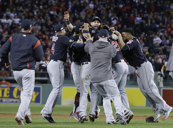 The Cleveland Indians celebrate their 4-3 win over the Boston Red Sox in Game 3 of baseball's American League Division Series, Monday, Oct. 10, 2016, in Boston at Fenway Park. Cleveland swept the Red Sox and is moving on to the ALCS.(Elise Amendola/AP Photo)