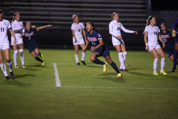 UConn's Toriana Patterson (#13) celebrates with Rachel Hill (#3) and (#21) Alana Moore. The Huskies beat UCF 3-0 on Thursday Oct. 13, 2016, at Joseph J. Morrone Stadium. (Zhelun Lang/The Daily Campus)