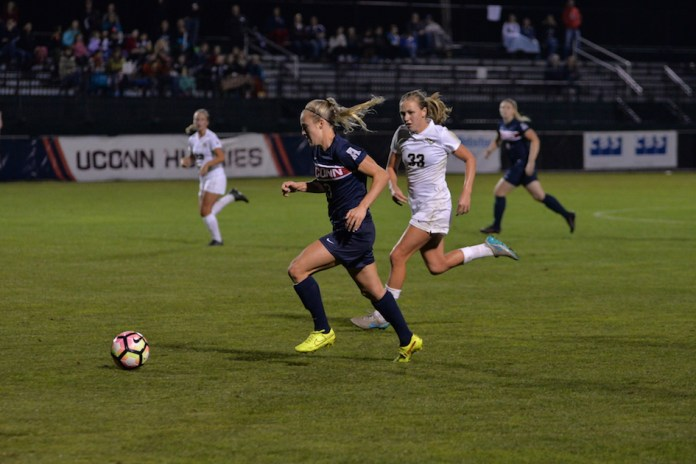 UConn senior forward Rachel Hill (#3) brings the ball up while being chased down by UCF junior defender Caroline Bado (#33) during a game on Thursday Oct. 13, 2016. UConn won the game 3-0 at Marrone Stadium. (Amar Batra/The Daily Campus)