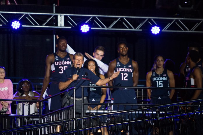 """Geno Auriemma speaks to the crowd during First Night on Friday, Oct. 14 at Gampel Pavilion. He pumped up the crowd by calling basketball season """"the best time of your life."""" (Jackson Haigis/The Daily Campus)"""