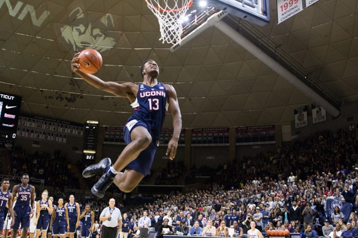 Sophomore forward Steve Enoch goes up for a dunk during the dunk contest at First Night on Friday, Oct. 14 at Gampel Pavilion. A late entry into the contest, he stole the show with a between-the-legs slam. (Jackson Haigis/The Daily Campus)
