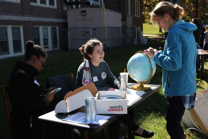 A group of UConn students gather at a table on campus. UConn found that gender gaps exist beyond STEM majors.(Ruohan Li/The Daily Campus)