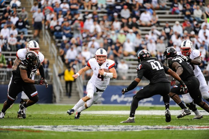 UConn quarterback and captain Bryant Shirreffs carries the ball down the field in the 20-9 win over Cincinnati on Saturday, Oct. 8, 2016. The Huskies fell to the Bulls in Tampa on Saturday, Oct. 15, 2016. (Jason Jiang/The Daily Campus)
