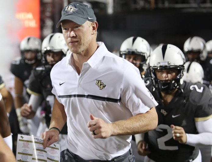 Central Florida coach Scott Frost leads his team onto the field for an NCAA college football game against Temple in Orlando, Fla., on Saturday, Oct. 15, 2016. (Stephen M. Dowell/Orlando Sentinel via AP)
