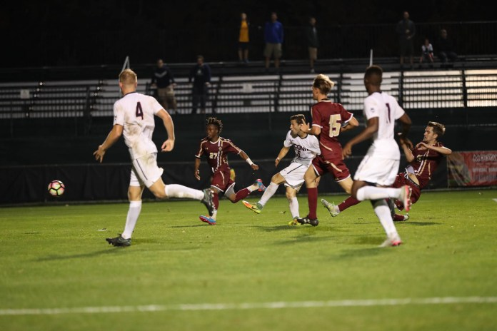 UConn defender Dylan Greenberg (6) shoots the game winning goal of the Huskies 1-0 overtime shutout against Boston College on Tuesday, Oct. 18, 2016 at Morrone Stadium. UConn recorded 14 shots on goal while BC recorded only 4. (Owen Bonaventura/The Daily Campus)