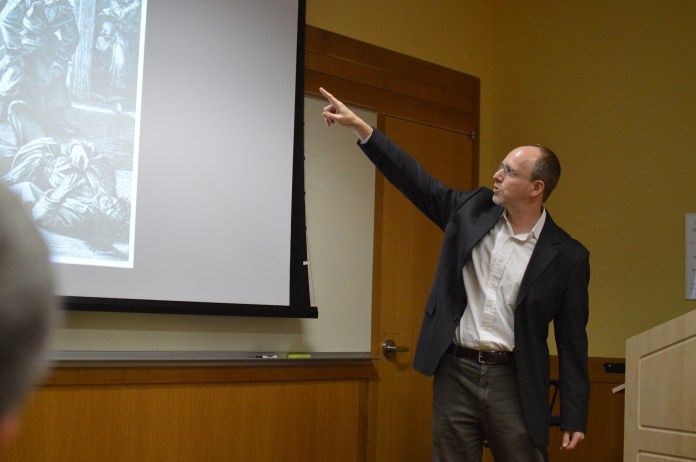 Professor Glenn Dynner lectures the economic history of the Jewish community in Europe from the 16th century to 19th century at Class of '47 meeting room on Thursday, Oct. 20, 2016. (Miguel Morales/The Daily Campus)