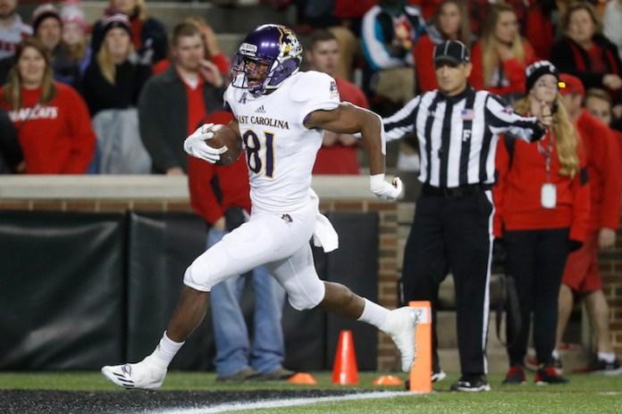 East Carolina wide receiver Jimmy Williams runs in a touchdown during the second half of an NCAA college football game against Cincinnati, Saturday, Oct. 22, 2016, in Cincinnati. Cincinnati won 31-19. (John Minchillo/AP)